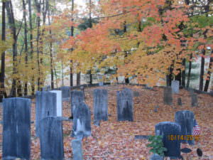 Pioneer graves decorated with fall leaves